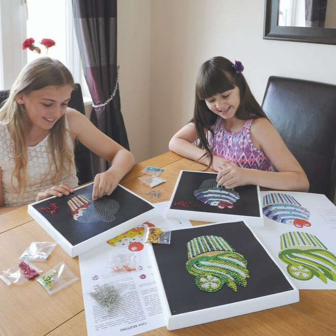Kids creating Cupcakes Sequin Art craft project